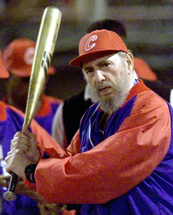 FILE PHOTO OF CUBAN LEADER CASTRO PRACTICING HIS BATTING