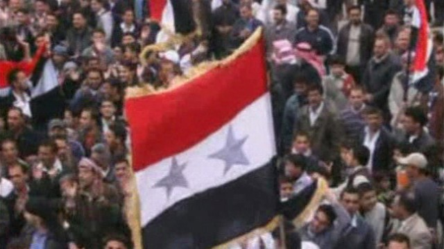 A still image taken from amateur video purportedly shows anti-government demonstrators rallying in Jasim, Deraa Governorate