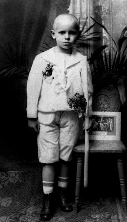 EARLY PHOTO OF POPE JOHN PAUL II POSING AFTER RECEIVING FIRST COMMUNION