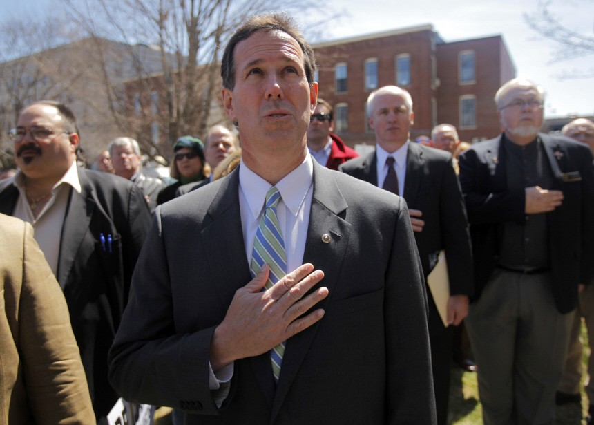 Former U.S. Senator and likely Republican Presidential candidate Santorum listens to the U.S. National Anthem at a Tax Payer Tea Party Rally in Concord