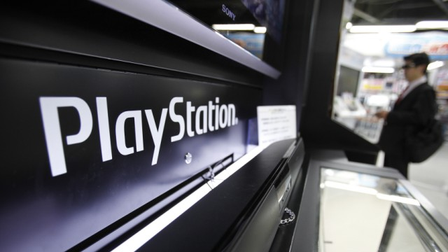 A man plays a game on Sony Corp's PlayStation 3 game console at an electronic store in Tokyo