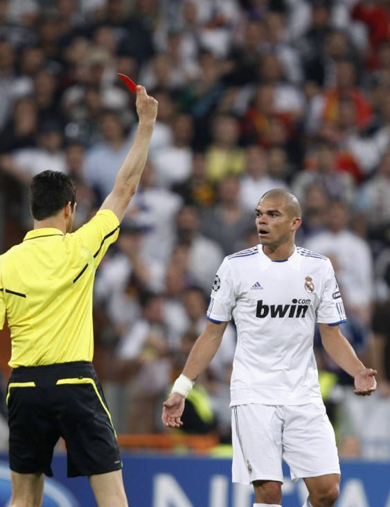 Referee Stark shows a red card to Real Madrid's Pepe during their Champions League semi-final first leg soccer match against Barcelona in Madrid