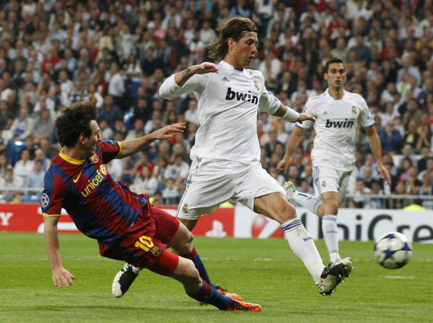 Barcelona's Messi shoots to score his second goal against Real Madrid during their Champions League semi-final first leg soccer match in Madrid