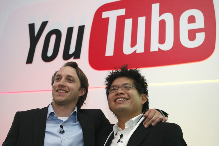 Chad Hurley and Steve Chen, co-founders of YouTube, pose after a news conference in Paris