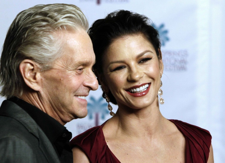 Actor Michael Douglas and his wife Catherine Zeta-Jones smile at the 22nd Annual Palm Springs International Film Festival Gala