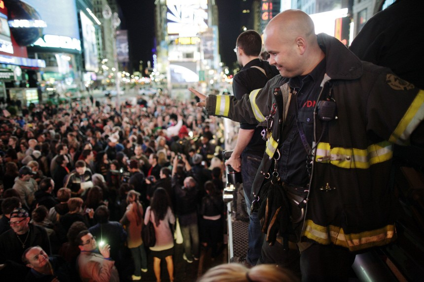 A firefighter waves to the crowd as people celebrate after Al Qaeda leader bin Laden was killed in Pakistan, in New York