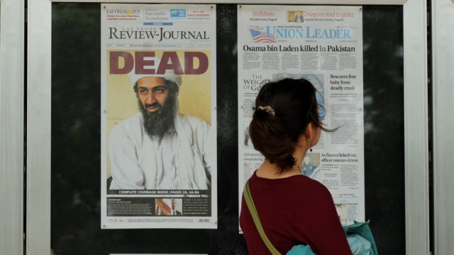 Newspaper front pages outside the Newseum show Osama bin Laden