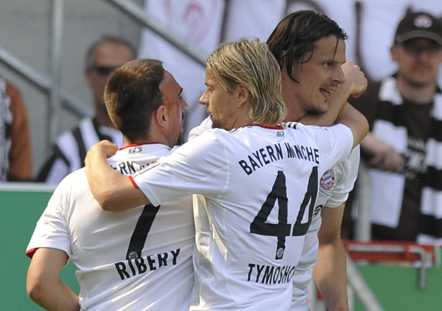 Bayern Munich's Ribery Tymoshchuk and Van Buyten celebrate after scoring during German Bundesliga first division soccer match against FC St. Pauli in Hamburg