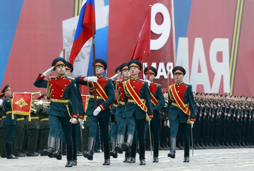 Russian military personnel march along Red Square during a military parade on Victory Day in Moscow
