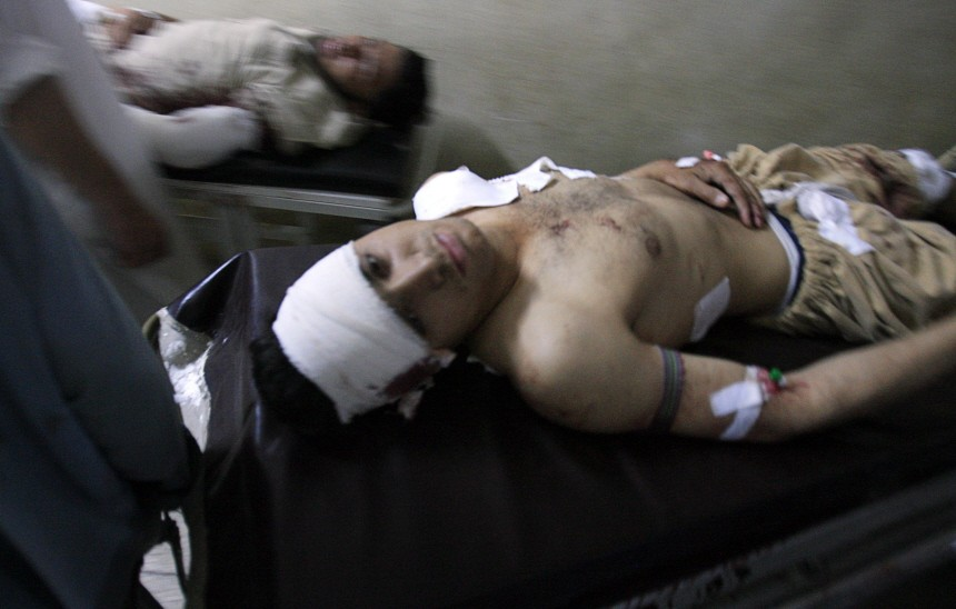 Victims of a suicide bomb blast in Charsadda pass each other on stretchers as they are treated at Lady Reading hospital in Peshawar