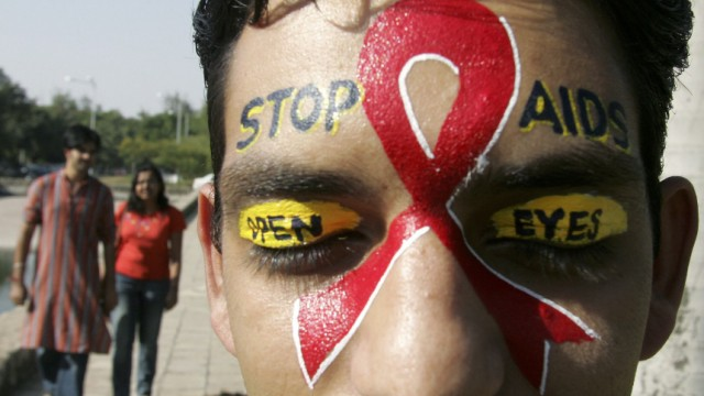 A volunteer from AIDS control society takes part in a campaign for AIDS awareness program in Chandigarh