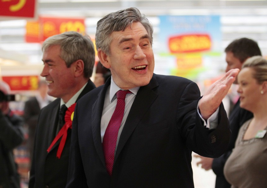 Former British Prime Minister Gordon Brown gestures during a visit to a supermarket in Livingston, in Scotland