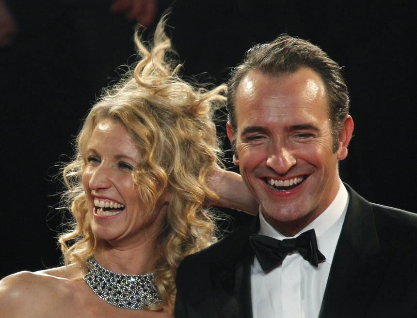 Cast members Dujardin and his wife actress Lamy leave the Festival Palace after the screening of the film 'The Artist' at the 64th Cannes Film Festival