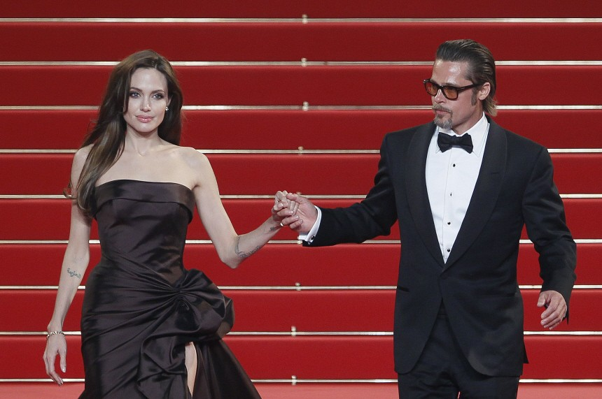 Cast member Pitt and actress Jolie leave the festival palace after the screening of the film 'The Tree of Life' in competition at the 64th Cannes Film Festival