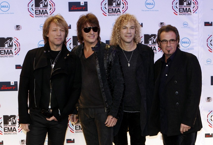 File picture shows members of Bon Jovi posing for photographers as they arrive for the MTV Europe Music Awards 2010 in Madrid