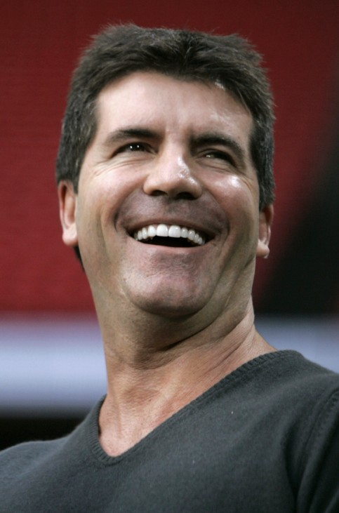 File photo of Simon Cowell smiling during the Concert for Diana at Wembley Stadium in London