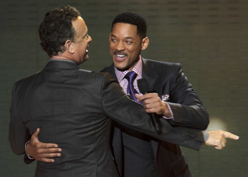 Actors Tom Hanks and Will Smith embrace during the taping of 'Oprah's Surprise Spectacular' in Chicago