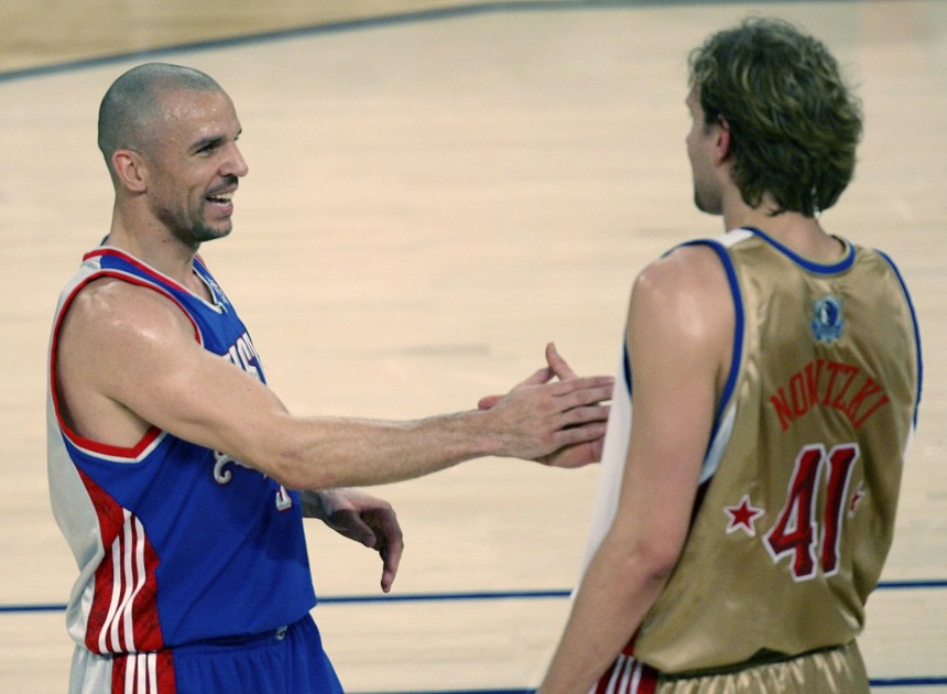 New Jersey Nets Jason Kidd shakes hands with Dallas Mavericks Dirk Nowitzki during the NBA All-Star basketball game in New Orleans