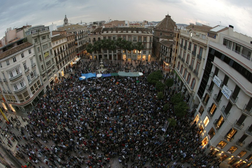 Demonstrators fill up La Constitucion square during a demonstration in Malaga, southern Spain