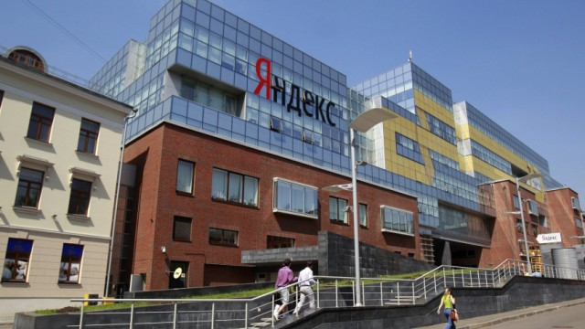 People walk near the headquarters of Yandex company in Moscow