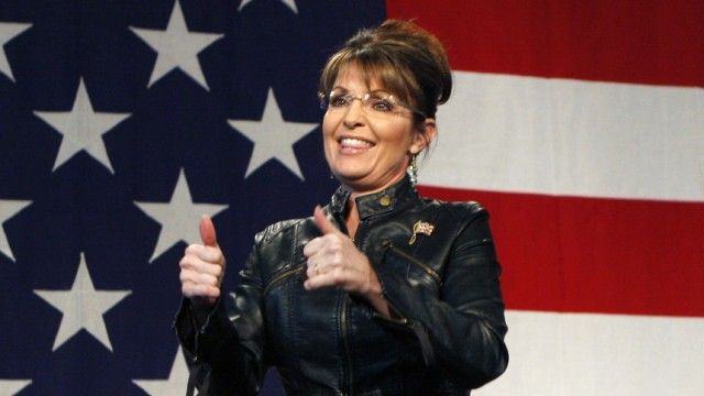 File photo of former Alaska governor and vice presidential candidate Sarah Palin acknowledging the crowd during a campaign rally for McCain in Tucson