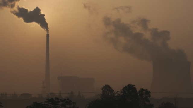 Smoke billows from a power plant on the outskirts of Hefei