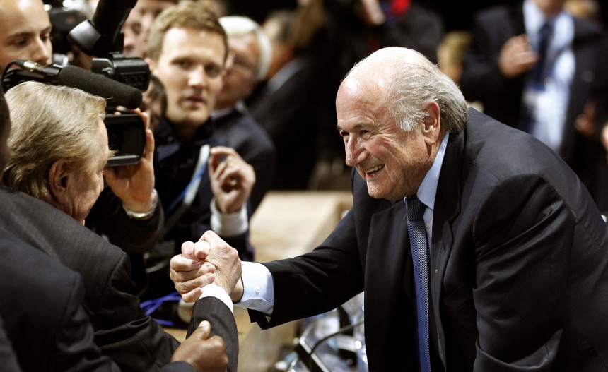 FIFA President Sepp Blatter receives congratulations after being re-elected for a fourth term during the 61st FIFA congress in Zurich