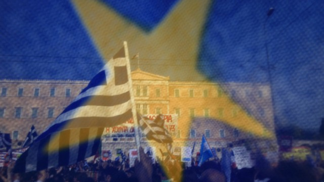Protesters are seen through an European Union flag, in front of the parliament building during a rally against a new austerity package at Constitution square in Athens