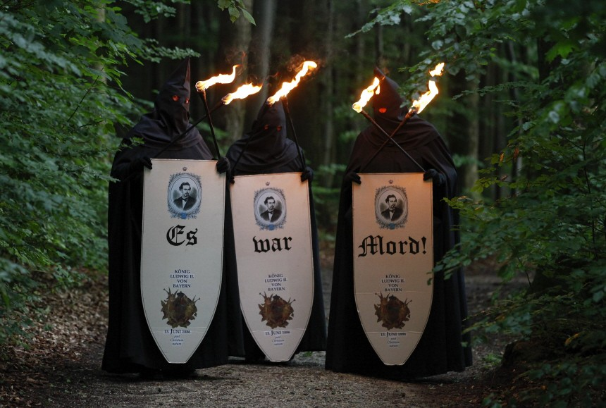 Members of the 'Guglmen', a secret society who believes that king Ludwig II of Bavaria was murdered, stand near the Starnberg lake in Berg