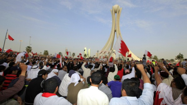 Thousands of Shi'ite protesters shout anti-government slogans at Pearl Square in Manama