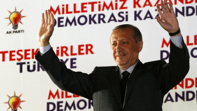 Turkey's Prime Minister Tayyip Erdogan greets his supporters at the AK Party headquarters in Ankara