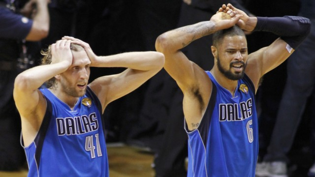 Dallas Mavericks forward Dirk Nowitzki and teammate Tyson Chandler react as they defeat the Miami Heat to win the NBA Championship in Miami