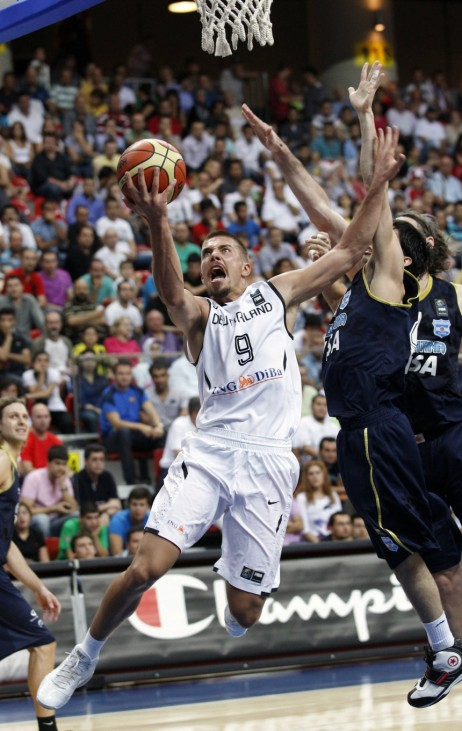 Germany's Hamann goes to the basket past Argentina's Prigioni during their FIBA Basketball World Championship game in Kayseri