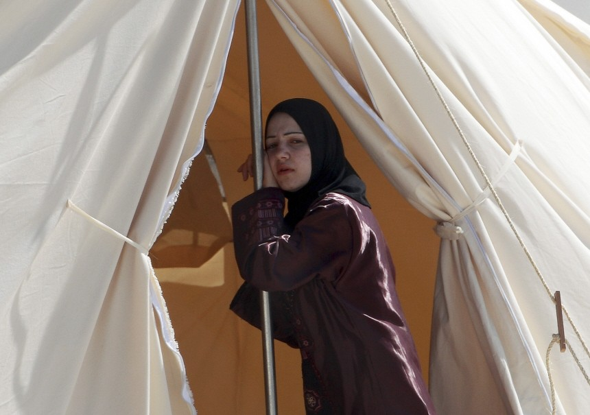 A Syrian refugee is seen in a refugee camp in the Turkish border town of Boynuegin in Hatay province