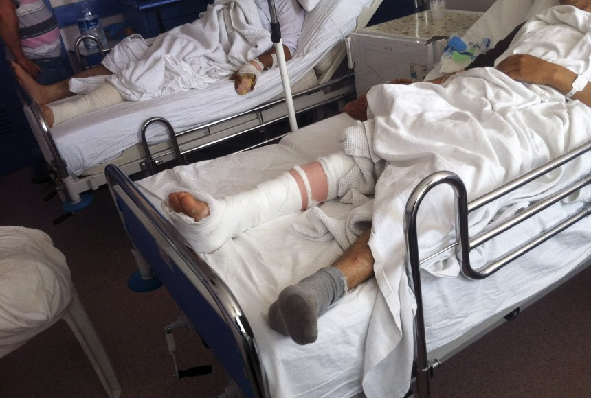 Wounded Syrian refugees on a hospital bed in Antakya city, Hatay province, close to the Syrian border