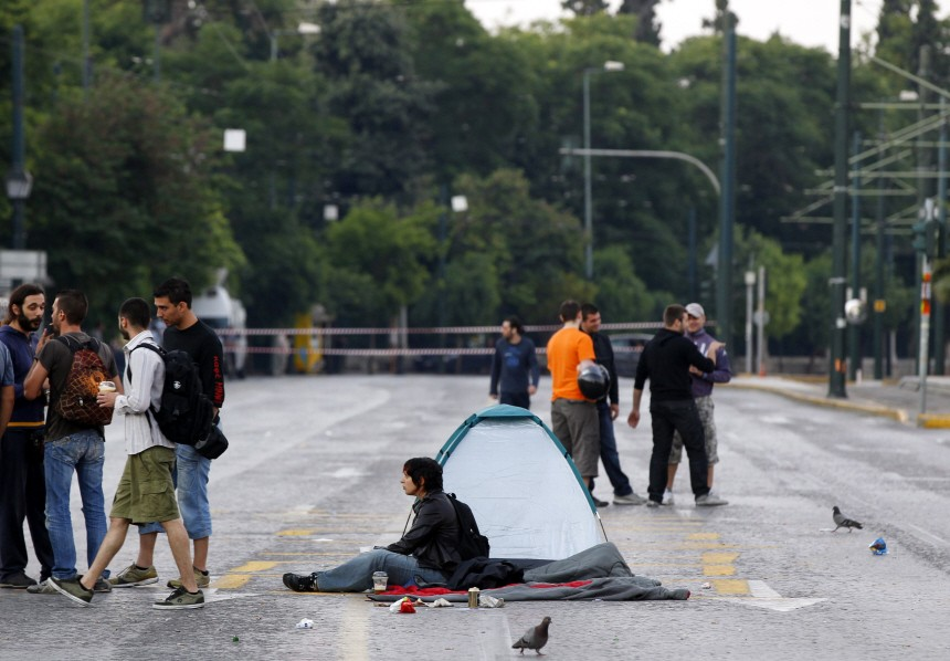 A protester camps outside the Greek parliament in Athens