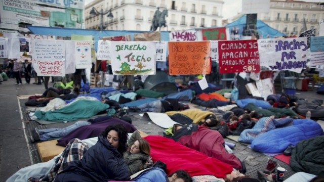 File photo shows demonstrators camping out in Madrid's Puerta del Sol