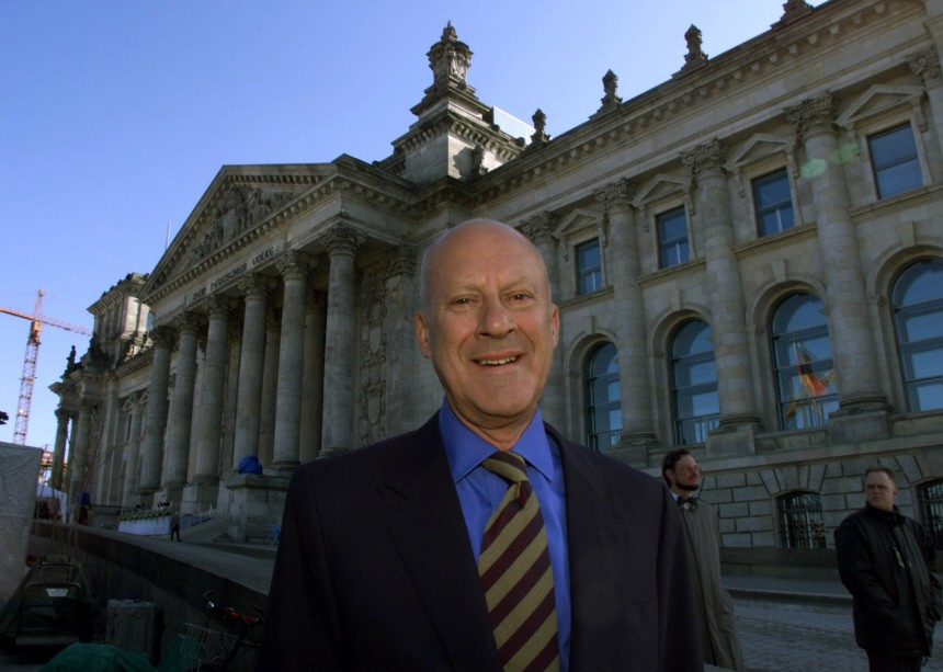 BRITAIN'S ARCHITECT SIR NORMAN FOSTER POSES IN FRONT OF THE RENEWED PARLIAMENT REICHSTAG IN BERLIN