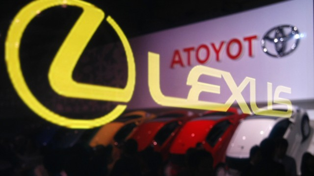 A Lexus logo on glass reflects a Toyota Motor Corp logo at the 41st Tokyo Motor Show in Chiba, east of Tokyo