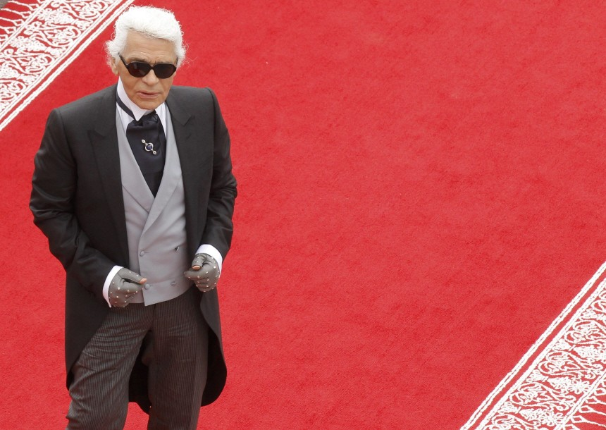 German designer Lagerfeld arrives to attend the religious wedding ceremony for Monaco's Prince Albert II and Princess Charlene at the Palace in Monaco