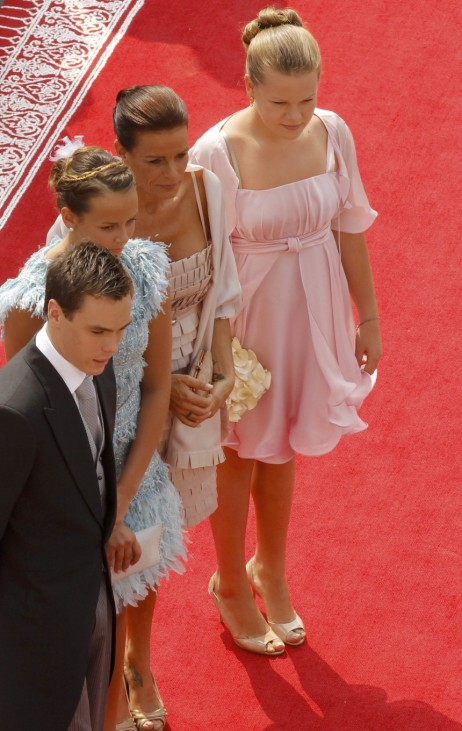 Princess Stephanie of Monaco and her children Louis Pauline and Camille arrive to attend the religious wedding ceremony for Monaco's Prince Albert II and Princess Charlene at the Palace in Monaco