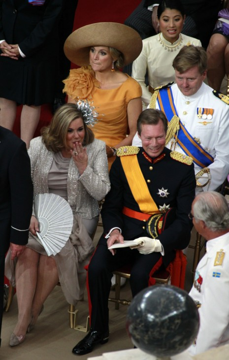 Grand Duchess Maria Teresa of Luxembourg blows a kiss towards King Carl XVI Gustaf of Sweden before the religious wedding ceremony of Monaco's Prince Albert II and Princess Charlene in Monaco