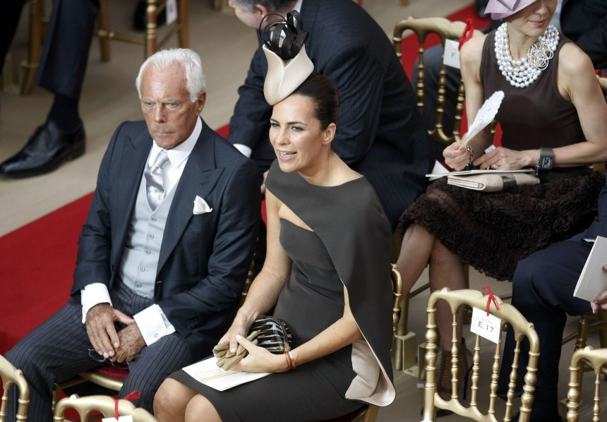 Italian designer Armani and his niece Roberta wait for the start of the religious wedding ceremony of Monaco's Prince Albert II and Princess Charlene in Monaco