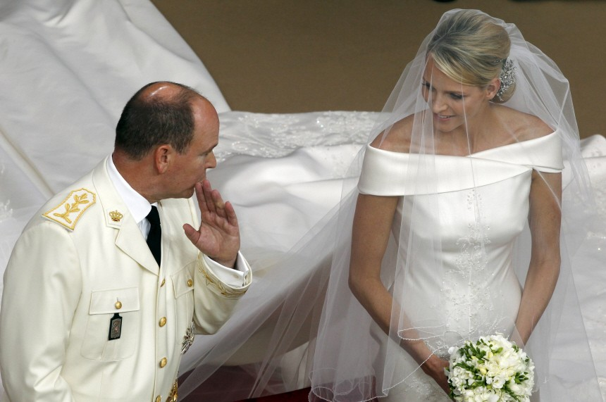 Monaco's Prince Albert II speaks with Princess Charlene during their religious wedding ceremony at the Palace in Monaco