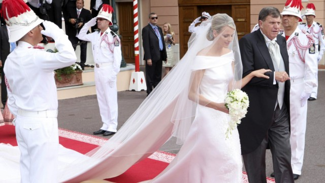 Michael Kenneth Wittstock escorts his daughter Princess Charlene on the red carpet at the Place du Palais
