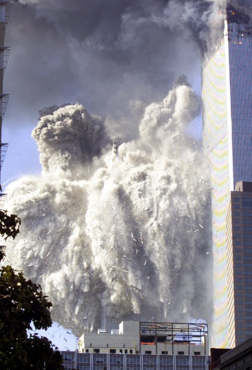 WORLD TRADE CENTER COLLAPSES AFTER PLANE CRASH