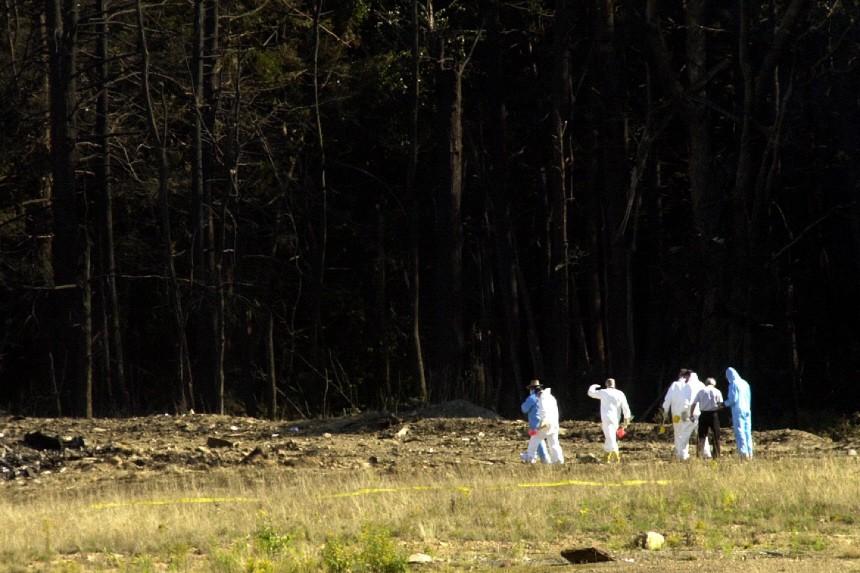 INVESTIGATORS HEAD INTO THE DEBRIS FIELD FOR PLANE CRASH NEAR PITTSBURGH