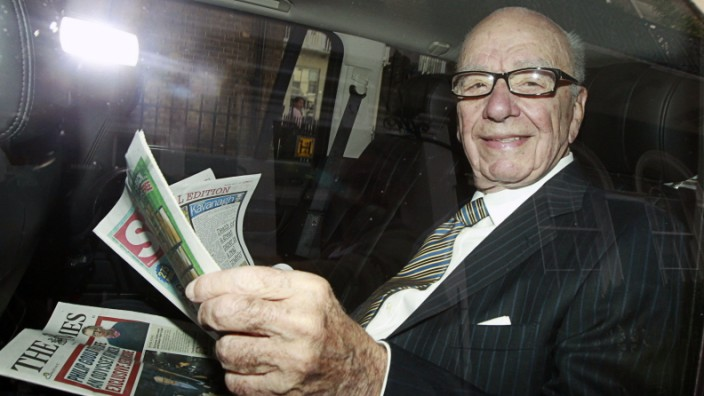 News Corporation CEO Rupert Murdoch is driven away from his flat in central London
