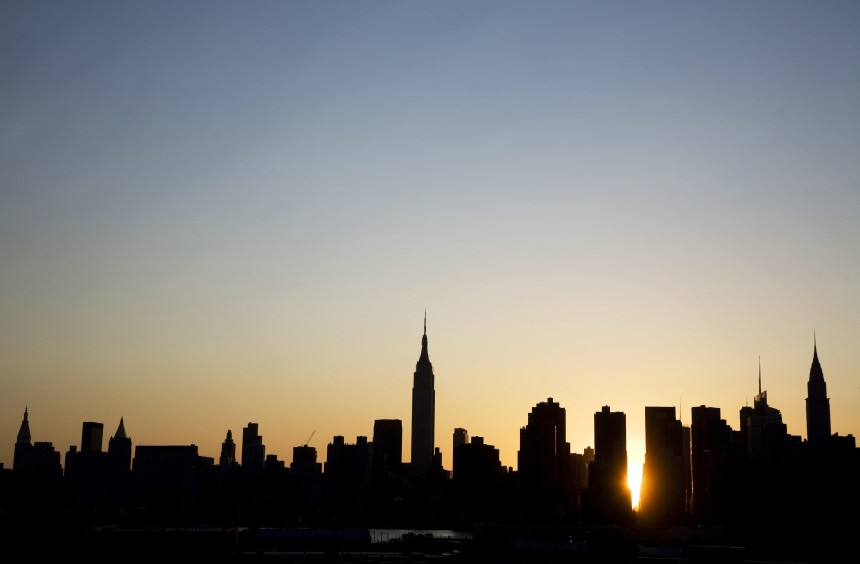 The sun sets over Manhattan aligned  exactly with the streets in a phenomenon known as 'Manhattanhenge' in New York