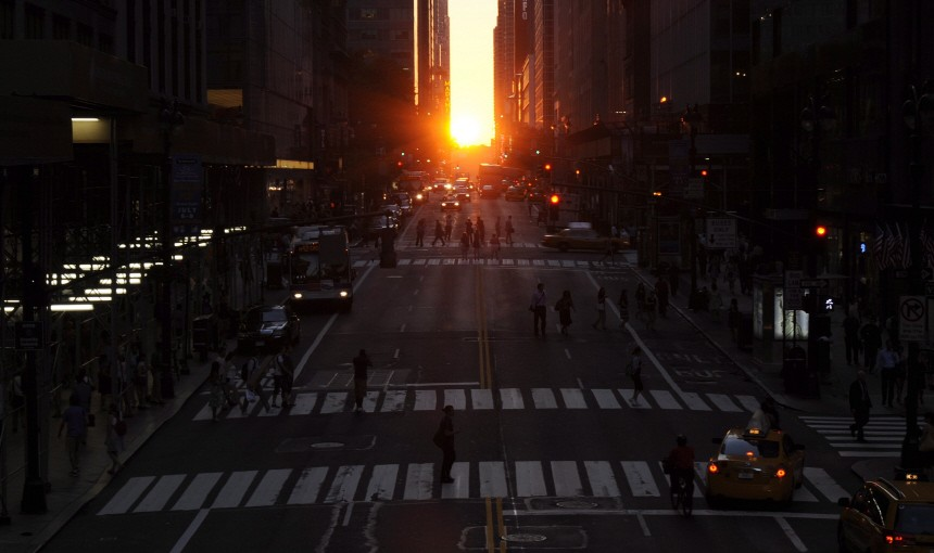 The sun sets over 42nd street during Manhattanhenge
